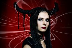 Woman in carnival costume. Witch shape Stock Photo