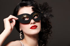 Woman in carnival mask Stock Images