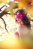 Woman in carnival mask. Autumn. Mystery woman in carnival mask. Autumn