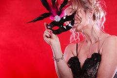 Woman with carnival mask. Royalty Free Stock Photography