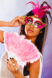 Woman with carnival masks holds fan Royalty Free Stock Photos