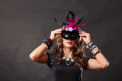 Woman with carnival venetian mask on dark Royalty Free Stock Image