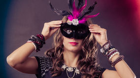 Woman with carnival venetian mask on dark Stock Images