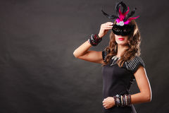 Woman with carnival venetian mask on dark Stock Image