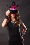 Woman with carnival venetian mask on dark Stock Photos
