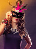 Woman with carnival venetian mask on dark Stock Photography