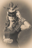 Woman with carnival venetian mask on dark Royalty Free Stock Photos