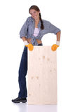 Woman carpenter holding wooden plank Stock Photo