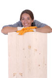 Woman carpenter holding wooden plank Stock Photos