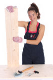 Woman carpenter holding wooden plank Royalty Free Stock Photos