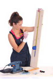 Woman carpenter with wooden plank Stock Photos