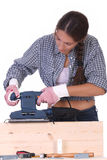 Woman carpenter at work, sander Royalty Free Stock Photos