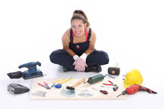 Woman carpenter with work tools Royalty Free Stock Photos