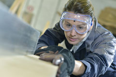Woman in carpentry professional training Royalty Free Stock Photos