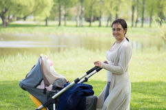 Woman with a carriage outdoor Stock Photography