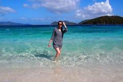 Woman at the Carribean Sea, St. Johns Island. Woman standing in water of the Carribean Sea at St. Johns Island, Virgin Islands Stock Photos