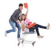 Woman carried by push cart Royalty Free Stock Image