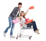 Woman carried by push cart. Held by man Stock Photo