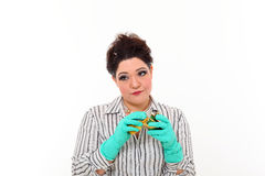 Woman in carrier cleaning a mug Royalty Free Stock Photography