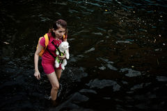 Woman carries a dog to evacuate Royalty Free Stock Photography