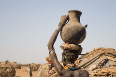 Woman carries on her head a container with water, Ethiopia Stock Images