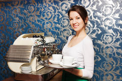 Woman carries a tray of coffee Stock Photo