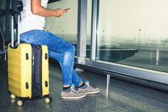 Woman carries your luggage at the airport terminal Stock Photos