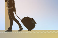 Woman carries your luggage at the airport terminal Stock Images