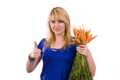 Woman with carrot Stock Photos