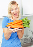 Woman with carrot royalty free stock photos