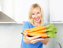 Woman with carrot Royalty Free Stock Photo
