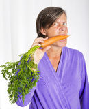 Woman with carrot Stock Photography