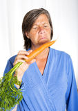 Woman with carrot Royalty Free Stock Photography