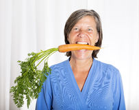 Woman with carrot Stock Photos