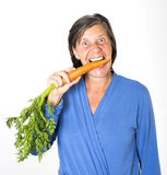 Woman with carrot Royalty Free Stock Image