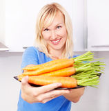 Woman with carrots Stock Image