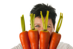 Woman with carrots Royalty Free Stock Images