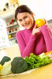 Woman with carrots. Yong woman with fresh vegetables Stock Photo