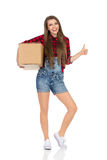Woman Carry Delivery And Showing Thumb Up Royalty Free Stock Photos