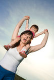 Woman carrying baby Stock Photography
