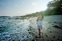 Woman Carrying Baby Beside the Seashore Royalty Free Stock Image