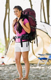 Woman carrying backpack at campsite. Woman carrying backpack at a campsite royalty free stock images