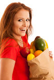 Woman carrying a bag full of various fruits isolated over white Royalty Free Stock Photography