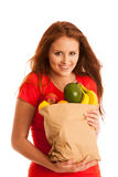 Woman carrying a bag full of various fruits isolated over white Royalty Free Stock Image
