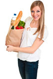 Woman carrying bag of groceries Stock Photography