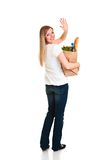 Woman carrying bag of groceries Stock Images