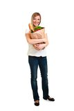 Woman carrying bag of groceries Royalty Free Stock Photography