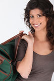 Woman carrying bag by handle Royalty Free Stock Images