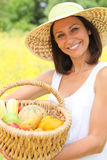 Woman carrying basket. Woman carrying fruit in basket stock image