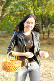 Woman carrying basket and apple Stock Image